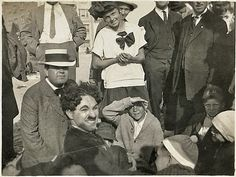"""Rarely seen photos taken by a Merritt J. Sibbald - a great candid of Charlie Chaplin and Edna Purviance, not enough of them and bottom Charlie Chaplin in fantastic close-up. Here crowds gathered at the beach to watch while Charlie shot his Essanay film """"By The Sea"""" (1915) on a windy day - Crystal Pier in Los Angeles.A one reeler (his last) he threw together between Niles and his Essanay Los Angeles studio.Collection of 6 auctioned off in 2008…"""