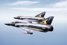 A Mirage III D (foreground) and Mirage III O aircraft of No. 2 Operational Conversion Unit RAAF in flight during a combined US-Australian Air Force exercise, Pacific Consort Royal Australian Navy, Royal Australian Air Force, Military Jets, Military Aircraft, Navy Aircraft, Fighter Aircraft, Fighter Jets, Avro Shackleton, Sharpies