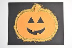 These chalk stenciled pumpkins are so easy and they're SO MUCH FUN! I love how the chalk on the dark paper makes the whole thing look like it's glowing!