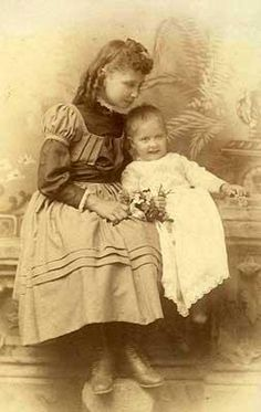 This photograph, circa 1888, depicts Helen with her younger sister, Mildred.  In her autobiography, The Story of My Life, Helen relates an incident where she once overturned her sister's cradle.  Had it not been for quick intervention by the girls' mother, Mildred could have been seriously hurt (or worse).
