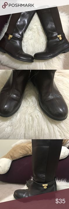 Micheal kors riding boots Really good condition worn 3 times, slight marking on the inner corners of both boots. But other than that they are in great condition. If you have any questions feel free to ask! Michael Kors Shoes Combat & Moto Boots