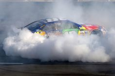 Kyle Busch Photos Photos - Kyle Busch, driver of the #18 M&M's Caramel Toyota, celebrates with a burnout after winning the Monster Energy NASCAR Cup Series Overton's 400 at Pocono Raceway on July 30, 2017 in Long Pond, Pennsylvania. - Monster Energy NASCAR Cup Series Overton's 400