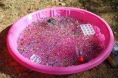 Water Beads - 1 lb. clear beads, 3x1/2 oz. bags colored beads. Put in pool the night before, and add 5 red Colored Bath Tabs - add clear containers