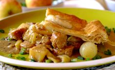 Steaming Sausage Pie: A pie with a difference - savour the flavours of onions, apples and bacon, topped with crisp pastry and served with minted peas.