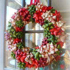 Holiday Wreath of premade bows. Make one this year from all the bows that often get thrown out after the presents are opened.