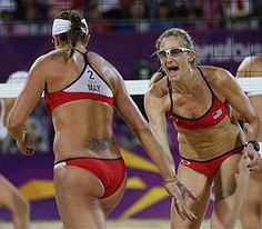 United States' Kerri Walsh Jennings, right, and Misty May-Treanor, left, react during the women's gold medal beach volleyball match against the other US team at the 2012 Summer Olympics today. Third Consecutive Gold Olympic Medal.