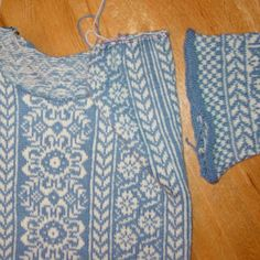 """Armhole (or lack thereof, until the steek / cutting stitches are cut open) in a traditionally knit Norwegian sweater design, my ladies' """"Wintergarden Pullover"""".  The steek, or """"cutting stitches"""" on the side of the body are sewn and cut open to fit the length of the finished sleeve.  The sleeve facing (solid blue) will be tucked inside and hemmed down to cover the cut edge. For pattern and / or knitting kit info, visit my on-line yarn shop, Kidsknits.com."""