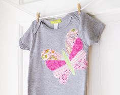 Baby Girl Butterfly Onesie- Heather Grey and Pink Handmade butterfly Applique Onesie- 6m 12m 18m- Baby Shower Gift. $32.00, via Etsy.