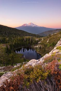 """Between the Light... Mt Shasta, """"White Mountain"""" is a volcano located at the southern end of the Cascade Range in Siskiyou County, California."""