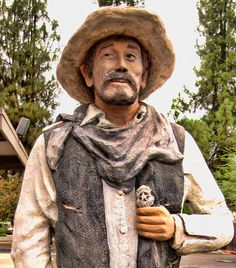 Clovis, CA.--  Festus statue, in Old Town. Ken Curtis, movie star and accomplished singer & actor,  who created the persona of Festus Haggen on TV's famous Gunsmoke series, retired to this area  and was a beloved figure around town. Photo by Karen McClintock.