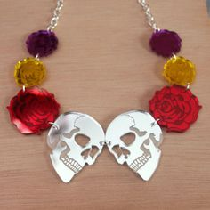 Dia De Los Muertos necklace - laser cut acrylic. £15.00, via Etsy.