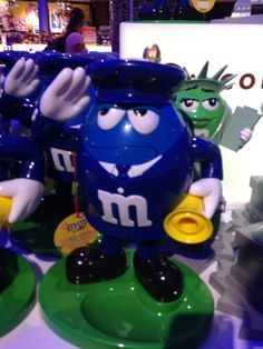 """M&M's World Blue Characters as Policeman Candy Dispenser New with Tags Made of hard plastic Hold 12oz. App. 10"""" Officially-licensed New with tags"""