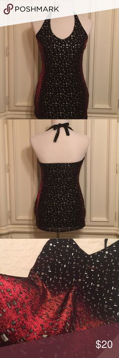 Backless Top Beautiful iridescent material covered with silver embellishments. The light reflects beautiful affects, as it changes from black to red, and back again! A holiday party necessity! Fully lined. Itchy size tag has been removed. Tops