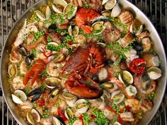 Looking at a large pan with paella that is cooking on the grill.Grab a grande grill and learn how to make Bobby's seafood-filled paella. Grilling Recipes, Seafood Recipes, Cooking Recipes, Rice Recipes, Catering Recipes, Seafood Meals, Grilling Ideas, Bbq Ideas, Cooking Videos