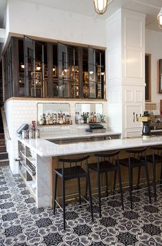 Beautiful kitchen with natural stone and patterned tile elements.