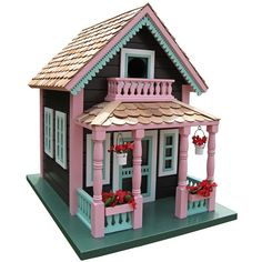 This bird house is an incredibly detailed smaller version of the beautiful homes in the town of Petoskey, Northern Michigan. Embellished with hanging flower bas...