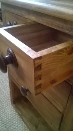 All drawers are dovetailed with teak handles.