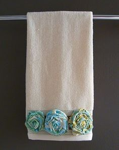 Shabby Fabric Roses...createanddelegate.blogspot has a tute 04/2010.   Love them on the towels.