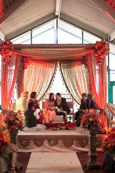 beautiful canopy on this Indian Hindu ceremony wedding - the tassles on the drapes are darling and I love the gold swagging and flowers.