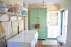Find an older, vintage pantry or microwave table to keep your detergents, clothespins and everything else you have hiding in your laundry room. These pieces will be functional but also add some prettiness into he mix too.