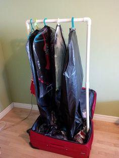 DIY portable clothes rack in suitcase for recitals. Genius.