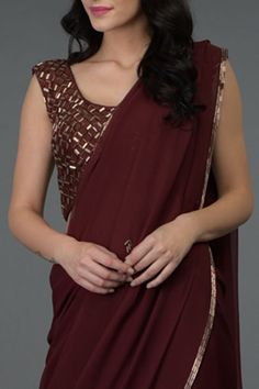 From our sheer glamour collection, this is a burgundy pure chiffon saree adorned with bugle beads (dispersion of dark and gold) hand embroidered borders and sprinkled bootahs on pallav and skirt. Saree Blouse Patterns, Fancy Blouse Designs, Sleevless Saree Blouse, Plain Chiffon Saree, Saree Trends, Stylish Dress Designs, Saree Models, Stylish Sarees, Saree Look