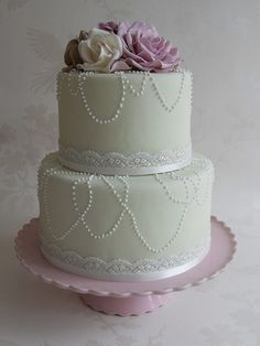 fondant with lace bottom boarder and buttercream dotting