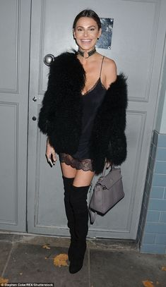 Party girl: Misse set off her thigh-skimming look with a pair of thigh-high suede boots, and wrapped up warm in a faux fur jacket