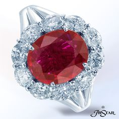 Style 2314 Ruby diamond ring featuring a certified 3.33 ct 'no heat' Mozambique vivid red ruby encircled with 10 carefully matched oval diamonds. Platinum #ruby #rubyring #diamonds