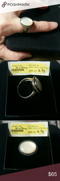 Ring NWOT.  Mother-of-Pearl Cabochon surrounded by silver beads and set in 6.7gms of Sterling Silver.  Can be worn by either male or female.  Size 9. Jewelry Rings