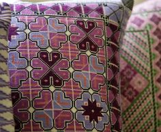 embroidered pillows by jordanian women modeled on the country's traditional dress designs via. elledecor ayadeena.com