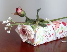 Hand made cold porcelain Rose and Gypsophelia for gift wrapping a birthday present.