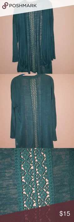 Maurice's long sleeve open sweater Beautiful teal colored sweater, lightweight. Very comfortable. Long length (covers the backside!) Really cool detail down the center of the back of the sweater. EUC. Hardly worn. Maurices Sweaters Cardigans