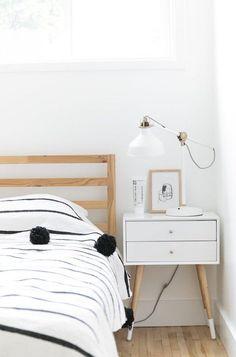 White mid-century nightstand in a Scandinavian Bedroom via Farah Prochaska Scandinavian Bedroom Decor, Scandinavian Interior Design, Scandinavian Home, Ikea White Dresser, Minimalist Room, Headboard And Footboard, White Pillows, Nightstand Ideas, Monochrome