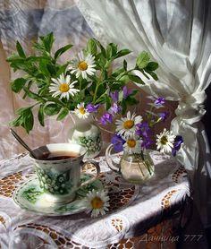 Tea Cup enhanced by pretty arrangement of flowers....