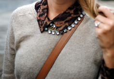 i just tried this and loved it- necklace on outside of collar