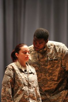 "FORT GORDON, Georgia -- Jeanne Morales (left) portrays an Army private who is being sexually harassed by her drill sergeant, portrayed by Kenneth Bowen, in a quid pro quo scene during the performance ""I AM STRONG"" at Alexander Hall, April 18."