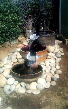 Water Garden Wine Barrel Water Feature Great way to enjoy a nice serene water feature We specialize in custom designs Wine Barrel Water Feature, Wine Barrel Garden, Wine Barrel Crafts, Barrel Fountain, Tabletop Fountain, Barrel Projects, Wine Barrel Furniture, Garden Fountains, Water Fountains
