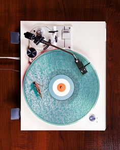 Mike Pillaser. I love how the record player is a pool. Someone is swimming in the pool as well. Very good scale.