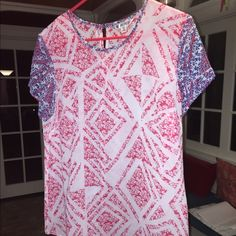 Cabi red, white & blue top Such a cute, flowing  shirt!!  Very lightweight!  Needs a tank or cami underneath because it's see through.  One button in the back CAbi Tops Blouses