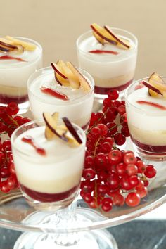 Fresh berry desserts. Sweet and creamy delights with gooseberry garnish.