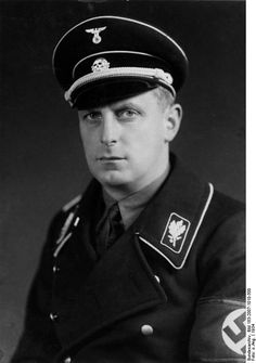 SS-Obergruppenführer and General of the Waffen SS and Police Werner Lorenz was chief of Main Ethnic German Resettlement Central Office, known as VoMi. VoMi was charged with deporting native populations from the occupied eastern territories in order to make room for ethnic Germans to settle inside the Reich. After the war, he was tried as war criminal and sentenced to 20 years. He was freed in 1955 and died in Hamburg in 1974.