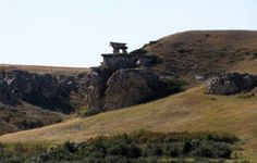 Table Rock is a dual pedestal hoodoo in Writing-On-Stone Provincial Park, south-central Alberta, Canada.