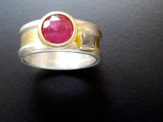 Ruby Promise Fabricated sterling and gold engagement ring with customer's naturally included ruby accented with rough diamond brut, com. Gold Engagement Rings, Wedding Rings, Jewelry Rings, Jewellery, Rough Diamond, Love Design, Metal Working, Addiction, Gemstone Rings