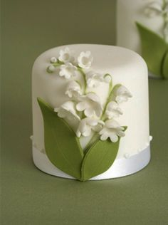 Today, many couples opt for less-extravagant cakes. One idea is to create a miniature couple's cake to cut and to serve an assortment of sweets like pies, cupcakes, or doughnuts for guests. We like the delicate lily of the valley adornment that symbolizes Grace's bouquet. Source