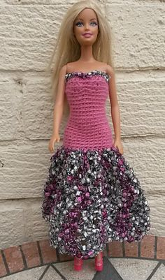 The dress is made in crochet rounds, from the top down, with a shaped bodice and shaped over the hips so the skirt is lower at the back. The bodice is very tight fitting so be careful with tension.