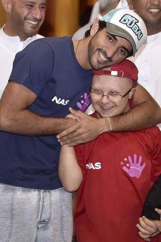 Sheikh Hamdan bin Mohammed bin Rashid Al-Maktoum, Crown Prince of Dubai, and a boy with Downs Syndrome, photos by Hamdan bin Mohammed @HamdanMohammed on Twitter