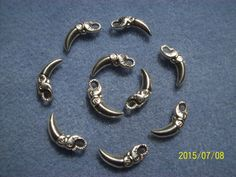 Tibetan Silver Elephant Tusk Charms by GetStoneCreations on Etsy