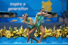 Synchronized Swimming Style: An Appreciation Post: Another great thing about synchro is all the funny routines the swimmers do before getting into the water. These two from Switzerland had a Charlies Angels-type thing going on. Also? There swimsuits are stacks of money, cinched in the middle. Amazing.