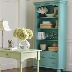 Very Beachy Feel. Blue mixed with the minty green color. Love all the textures mixed together on the bookshelf.